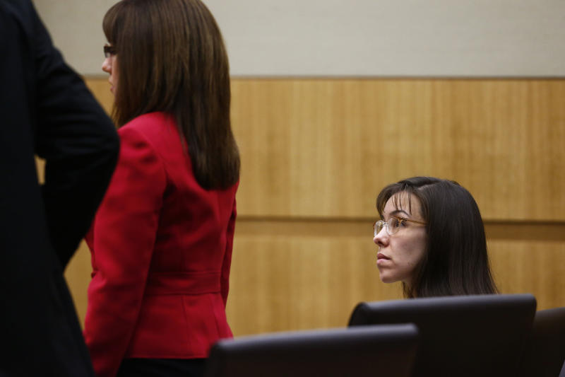 Jodi Arias watches as her defense attorneys Jennifer Wilmott, center, and Kirk Nurmi ask to withdraw from the case on Monday, May 20, 2013, during the penalty phase of her Arias' murder trial at Maricopa County Superior Court in Phoenix, Ariz.  The judge promptly denied their request. Arias was convicted of first-degree murder on May 8, 2013 in the stabbing and shooting to death of Travis Alexander, 30, in his suburban Phoenix home in June 2008. (The Arizona Republic, Rob Schumacher, Pool)
