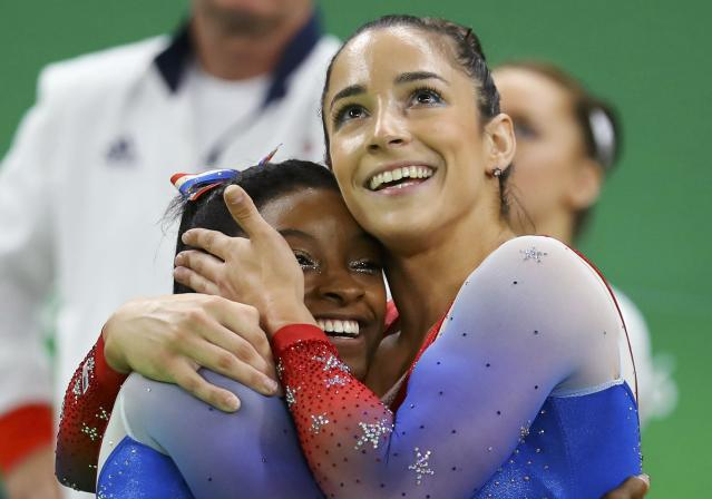 2016 Rio Olympics - Artistic Gymnastics - Final - Women's Floor Final - Rio Olympic Arena - Rio de Janeiro, Brazil - 16/08/2016. Simone Biles (USA) of USA (L) and Alexandra Raisman (USA) of USA (Aly Raisman) celebrate winning the gold and the silver respectively. REUTERS/Mike Blake TPX IMAGES OF THE DAY. FOR EDITORIAL USE ONLY. NOT FOR SALE FOR MARKETING OR ADVERTISING CAMPAIGNS.