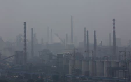 A steel factory is seen in smog during a hazy day in Anshan