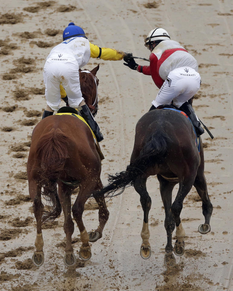Joel Rosario, right, riding Orb is congratulated by Robby Albarado riding Golden Soul after Orb won the 139th Kentucky Derby at Churchill Downs Saturday, May 4, 2013, in Louisville, Ky. (AP Photo/Charlie Riedel)