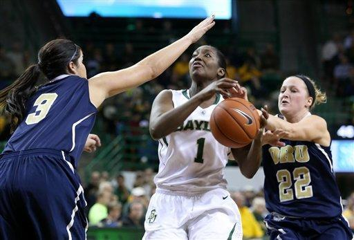 Oral Roberts' Taylor Cooper (3) and guard Jaci Bigham (22) defend against a drive to the basket by Baylor's Kimetria Hayden (1) in the first half of an NCAA women's basketball game on Wednesday, Dec. 12, 2012, in Waco, Texas. (AP Photo/Rod Aydelotte, Waco Tribune Herald)