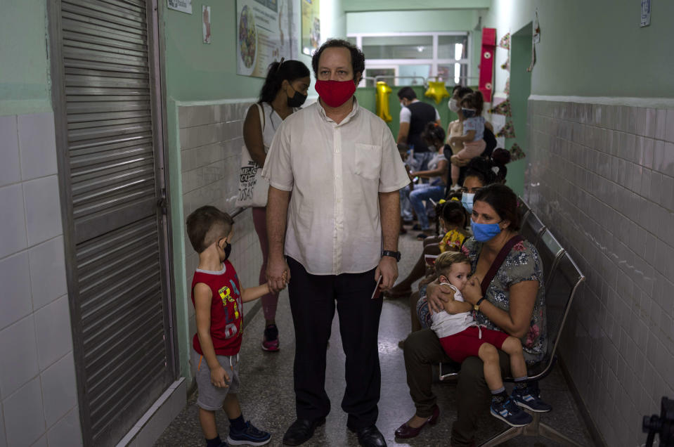 Parents wait to have their children vaccinated with the Soberana-02 COVID-19 vaccine, in Havana, Cuba, Thursday, Sept. 16, 2021. Cuba began inoculating children as young as 2-years-old with locally developed vaccines on Thursday. (AP Photo/Ramon Espinosa)