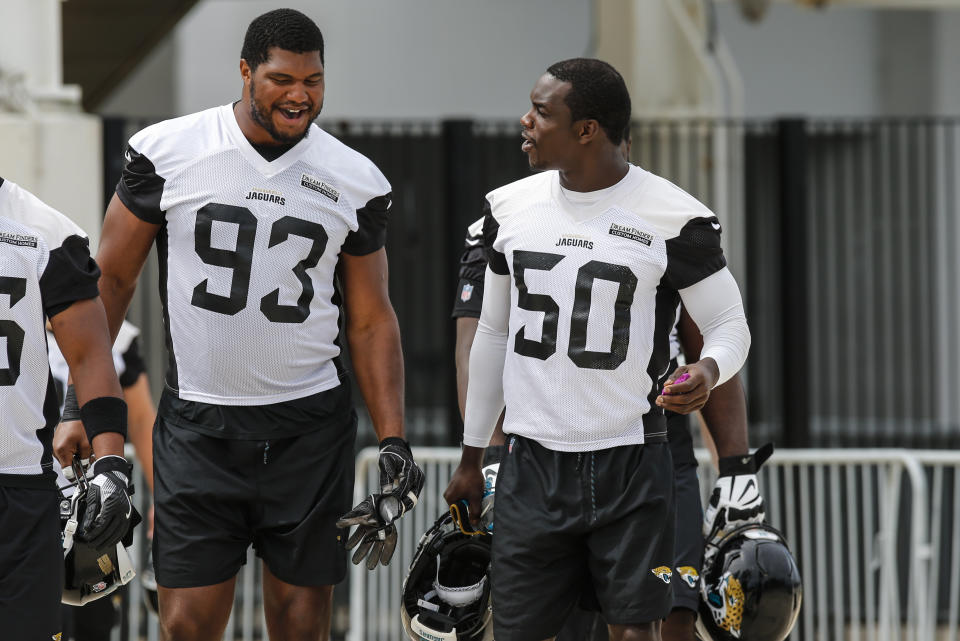 Jacksonville Jaguars defensive lineman Calais Campbell (93) and linebacker Telvin Smith (50) walk out to the practice field on June 14, 2018. (David Rosenblum/Getty Images)