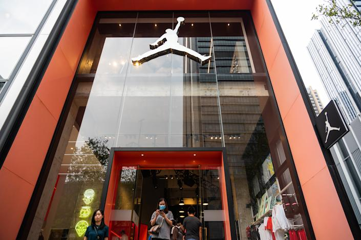SHENZHEN, CHINA - 2020/10/04: Customers are seen at an Air Jordan store in Shenzhen. (Photo by Alex Tai/SOPA Images/LightRocket via Getty Images)