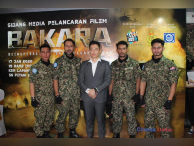"""Adrian Teh with the main cast of """"Bakara"""" at the movie's launch last year."""