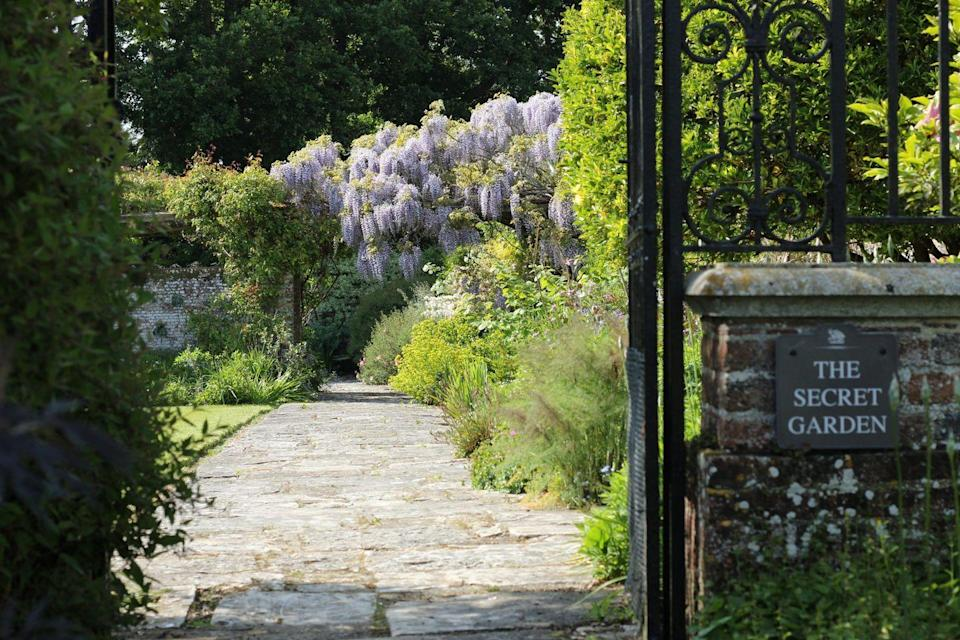 """<p>Great Maytham Hall in Kent, England, is home to the most popular """"secret"""" garden on this list, as it is the very garden that inspired Frances Hodgson Burnett's bestselling novel, <em><a href=""""https://www.amazon.com/Secret-HarperClassics-Frances-Hodgson-Burnett/dp/006440188X"""" rel=""""nofollow noopener"""" target=""""_blank"""" data-ylk=""""slk:The Secret Garden"""" class=""""link rapid-noclick-resp"""">The Secret Garden</a></em>. The property's gardens were designed by British architect Sir Edwin Lutyens, a leader of the Arts and Crafts movement known for designing the former British Indian capital of New Dehli, and landscape designer Gertrude Jekyll. Herbaceous blooms, a rose pergola, and, of course, a gated entry are just a few of the features that make Great Maytham Hall so glorious. </p>"""