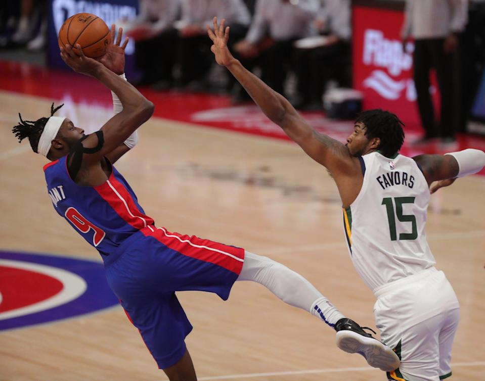 Pistons forward Jerami Grant scores against Jazz center Derrick Favors during the second period at Little Caesars Arena on Sunday, Jan. 10, 2021.