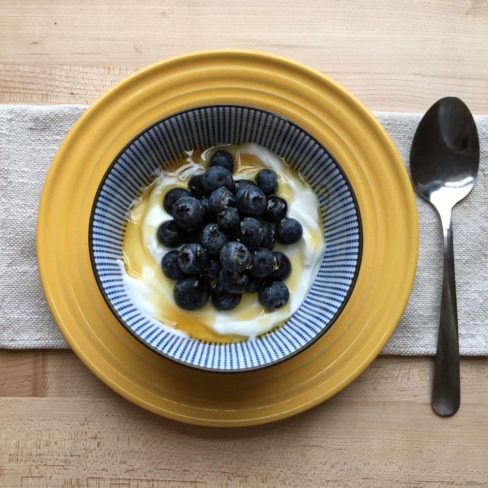 <p>A simple combination of Greek yogurt and blueberries gets an extra touch of sweetness from golden honey. It's the perfect balance of protein and fiber to keep you energized</p>