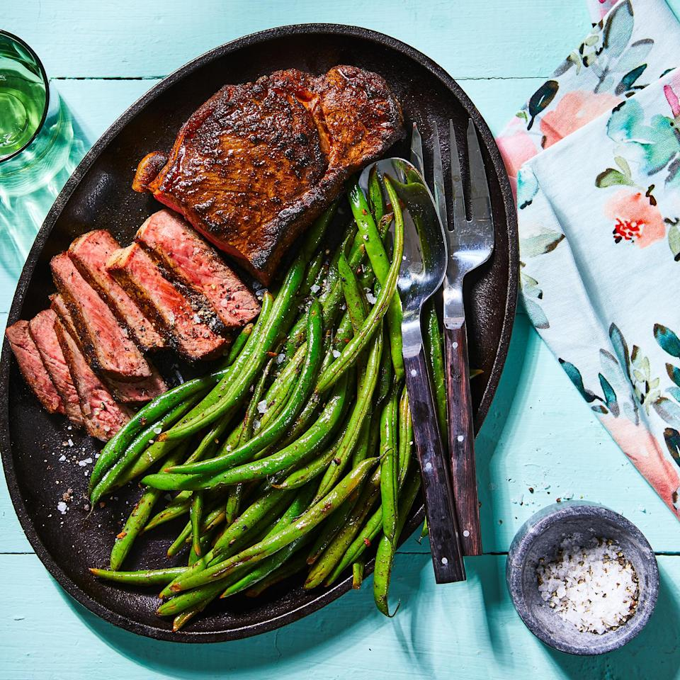<p>For a steak that's deliciously tender, flavorful and not too fatty, we reach for strip (also known as New York strip or shell steak). It has less than half the saturated fat of a rib-eye but is more tender than leaner sirloin. Here, we cook green beans in the same pan used to sear the spiced steak. All those delicious drippings add richness to the beans—plus there's one less pan to wash!</p>