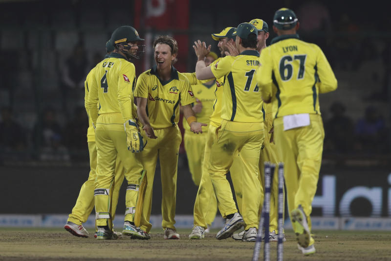 Australian players celebrate the dismissal of India's Rohit Sharma during the final one day international cricket match between India and Australia in New Delhi, India, Wednesday, March 13, 2019. (AP Photo/Altaf Qadri)