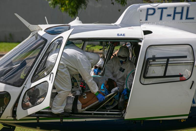 Brazilian Davi da Silva Alves, 39, resident of the Divino Espirito Santo community of the Pacaja River, who suffers from COVID-19 symptoms, is seen on a helicopter-ambulance to be transported from Breves, Para state, Brazil, to the Santa Casa de Misericordia Hospital in Belem, the state's capital, on June 8, 2020. (Photo by TARSO SARRAF / AFP) (Photo by TARSO SARRAF/AFP via Getty Images)