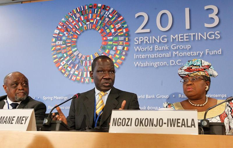 Ngozi Okonjo-Iweala, right, of Nigeria listens with Ali Soilihi, left, Vice President, Ministry of Finance and Economy, Budget, External Trade and Privatization, Union of Comoros as Alamine Ousmane Mey, center, Minister of Finance of Cameroon speaks during the new briefing by African Finance Ministers at the World Bank IMF Spring Meetings in Washington, April 20, 2013. (AP Photo/Molly Riley)