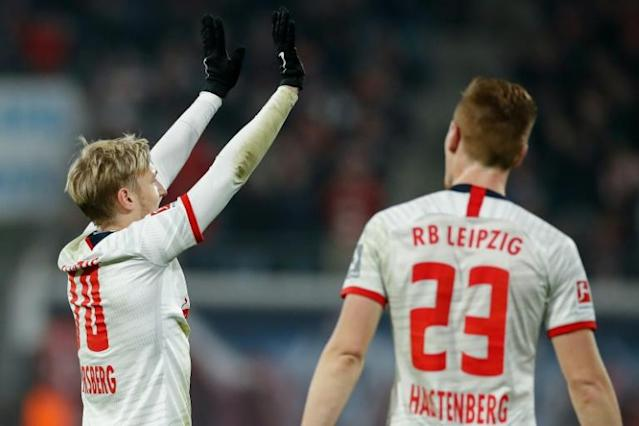 Leipzig's Swedish midfielder Emil Forsberg (L) celebrates scoring with a superbly struck free-kick against Cologne on Saturday (AFP Photo/Odd Andersen)