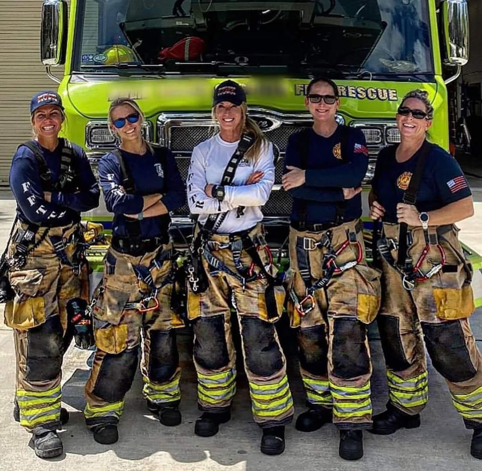 In this Sept. 19, 2020 photo provided by Palm Beach Gardens Fire and Rescue, firefighters lieutenant Krystyna Krakowski, lieutenant Kelsey Krzywada, fire medic Julie Dudley, lieutenant (acting captain) Monica Marzullo and driver engineer Sandi Ladewskipose at their station in Palm Beach Gardens, Fla. (Kodi Cabral/Courtesy of Palm Beach Gardens Fire and Rescue via AP)