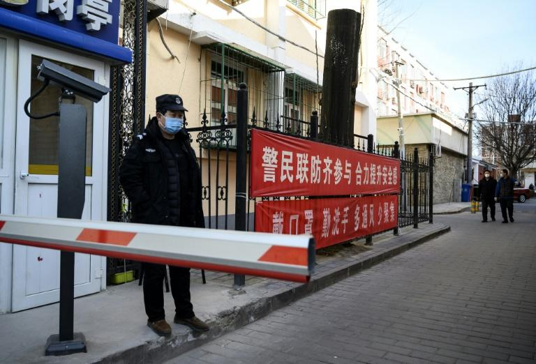Measures such as face masks and temperature checks have been implemented in Beijing to help control the spread of the virus (AFP Photo/NOEL CELIS)