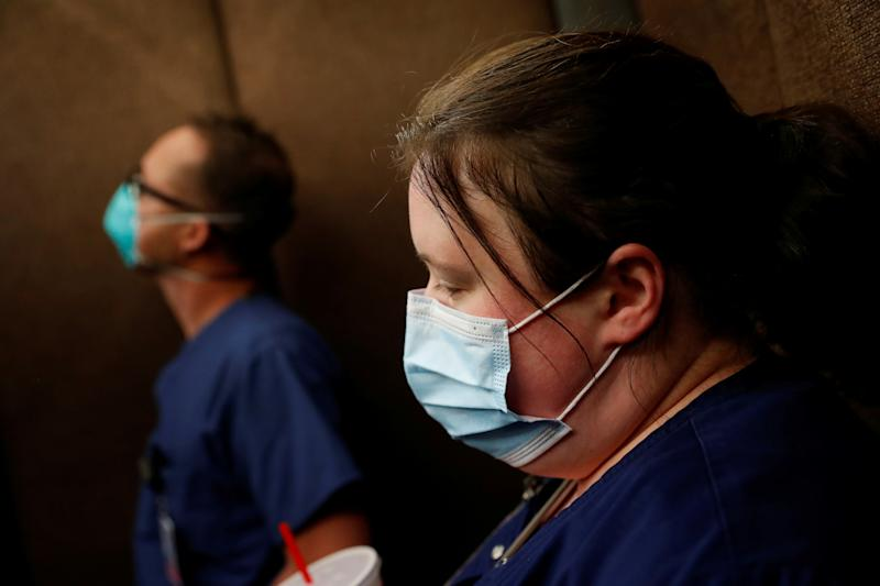 Traveling nurse Meghan Lindsey looks down wearing a protective face mask after her shift on Mother's Day in her hotel elevator hotel in the Queens borough of New York, U.S., May 10, 2020. Picture taken May 10, 2020. REUTERS/Shannon Stapleton TPX IMAGES OF THE DAY