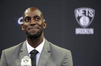 FILE - In this July 18, 2013 file photo, Kevin Garnett smiles as he speaks to reporters during an NBA basketball news conference in New York. Garnett and fellow NBA greats Tim Duncan and Kobe Bryant headlined a nine-person group announced Saturday, April 4, 2020, as this years class of enshrinees into the Naismith Memorial Basketball Hall of Fame. They all got into the Hall in their first year of eligibility, as did WNBA great Tamika Catchings. Two-time NBA champion coach Rudy Tomjanovich, longtime Baylor womens coach Kim Mulkey, 1,000-game winner Barbara Stevens of Bentley and three-time Final Four coach Eddie Sutton were selected. So was former FIBA Secretary General Patrick Baumann. (AP Photo/Mary Altaffer, File)