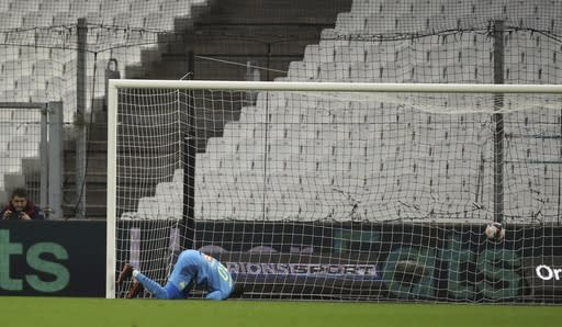 Lens' Simon Banza scores the opening goal of his team during the French League One soccer match between Marseille and Lens at the Veledrome stadium in Marseille, France, Wednesday, Jan. 20, 2021. (AP Photo/Daniel Cole)