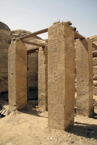 """This undated image released Friday, Nov. 2, 2012 by Egypt's Supreme Council of Antiquities, shows four limestone columns with hieroglyphic inscriptions in the recently discovered antechamber of the tomb of a pharaonic princess in the Abusir region, south of Cairo, Egypt. Egyptian Minister of Antiquities, Mohammed Ibrahim said Czech archaeologists have unearthed the tomb of Shert Nebti's, a pharaonic princess, daughter of King Men Salbo, dating from the fifth dynasty (around 2500 BC) along with four other tombs of """"high ranking officials."""" (AP Photo/Egypt's Supreme Council Of Antiquities)"""