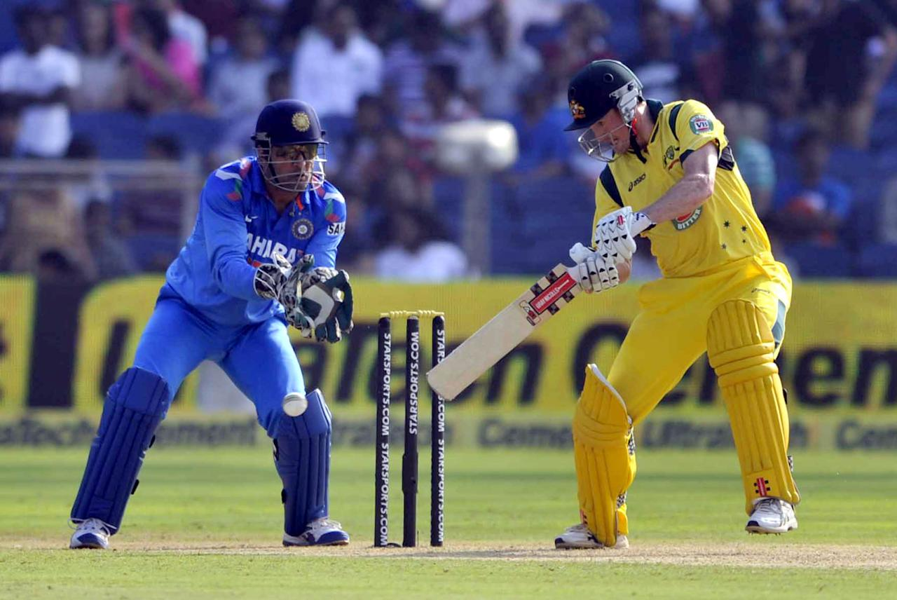 Australian skipper George Bailey plays a shot during the first ODI against India in Pune