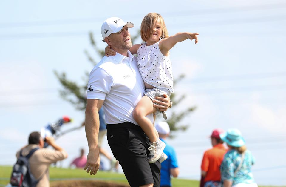 Mike Tindall walks off the 4th tee with his daughter Mia after teeing off during the Celebrity Cup charity fundraiser golf tournament at the Celtic Manor Resort in Newport, Gwent. (Photo by Andrew Matthews/PA Images via Getty Images)