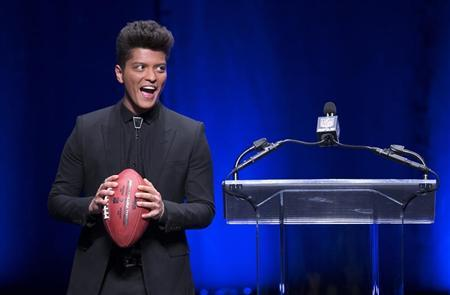 Singer Bruno Mars speaks at the Super Bowl half time press conference in New York, January 30, 2014. REUTERS/Carlo Allegri