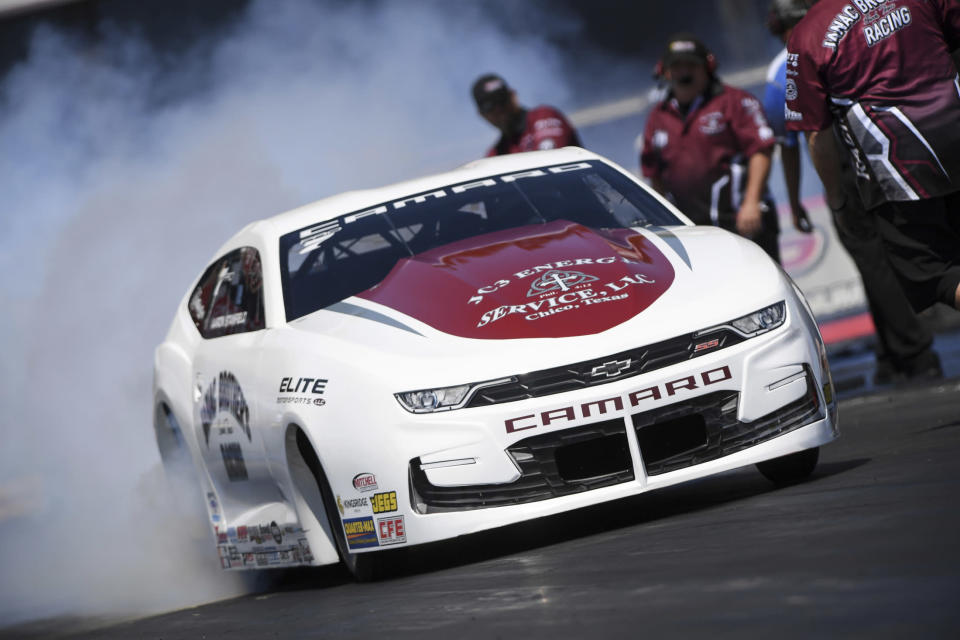 In this photo provided by the NHRA, Aaron Stanfield wins in the final round at the Lucas Oil NHRA Winternationals auto race as he went 6.652 seconds at 207.69 mph in his Pro Stock Chevy, Sunday, Aug. 1, 2021, in Pomona, Calif. (Marc Gewertz/NHRA via AP)