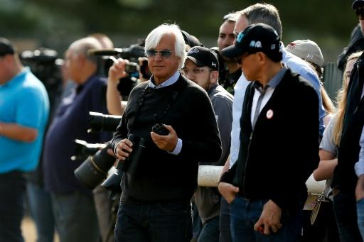 Bob Baffert (C), trainer of Triple Crown and Belmont Stakes contender Justify, seen during morning training prior to the 150th running of the Belmont Stakes, at Belmont Park in Elmont, New York, on June 8, 2018