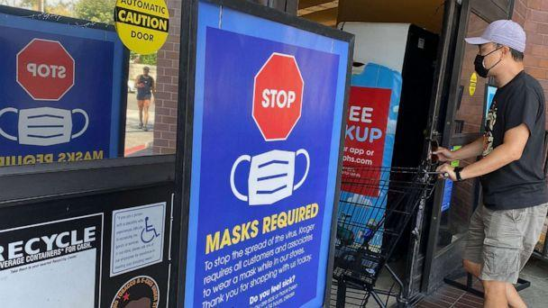 PHOTO: People shop at a grocery store enforcing the wearing of masks in Los Angeles on July 23, 2021. - With the Delta variant pushing US Covid cases back up, fully vaccinated people are wondering whether they need to start masking indoors again.  (Chris Delmas/AFP via Getty Images)