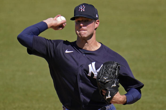 New York Yankees starting pitcher Corey Kluber delivers during the first inning of a spring training exhibition baseball game against the New York Yankees in Tampa, Fla., Saturday, March 13, 2021. (AP Photo/Gene J. Puskar