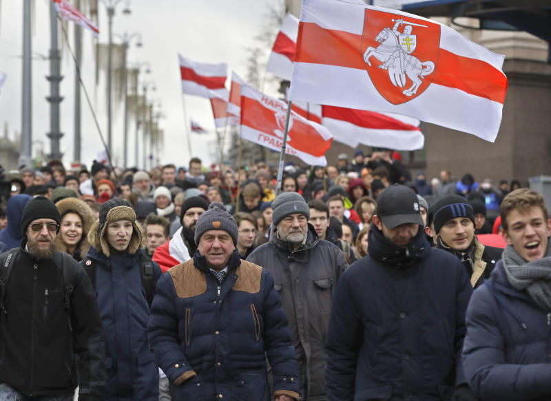 Protesters attend a procession in downtown Minsk, Belarus, Sunday, Dec. 8, 2019. A rally was held to protest closer integration with Russia which protesters fear could erode the post-Soviet independence of Belarus, a nation of 10 million. (AP Photo/Sergei Grits)