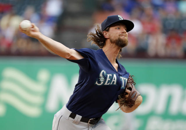 Seattle Mariners starting pitcher Mike Leake throws to the Texas Rangers in the first inning of a baseball game in Arlington, Texas, Tuesday, July 30, 2019. (AP Photo/Tony Gutierrez)