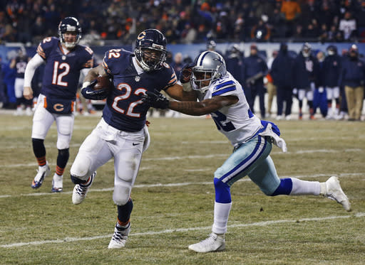 Chicago Bears running back Matt Forte (22) runs against Dallas Cowboys cornerback Orlando Scandrick (32) on his way to a touchdown during the second half of an NFL football game, Monday, Dec. 9, 2013, in Chicago. (AP Photo/Charles Rex Arbogast)
