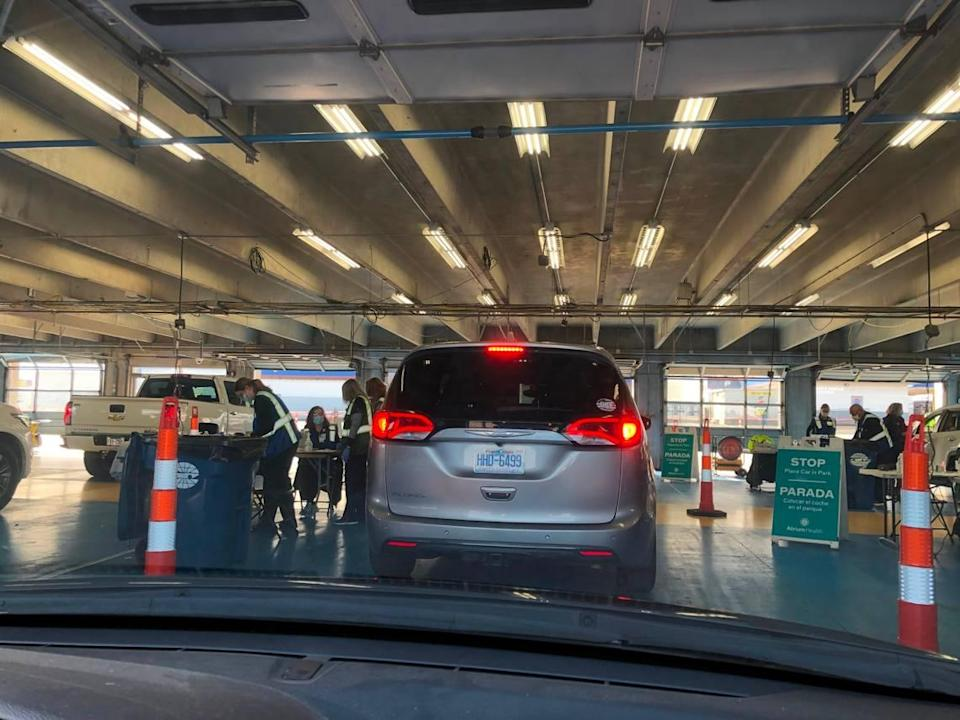 Cars pull into the garage of Charlotte Motor Speedway on Friday where the COVID-19 vaccines were given. The whole process took an hour, which included some travel time on the speedway's track. Photo courtesy of the Jennifer Halls.