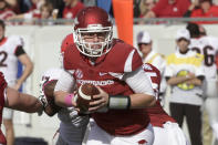 Arkansas quarterback Austin Allen looks to hand off during the first quarter of an NCAA college football game against Georgia in Little Rock, Ark., Saturday, Oct. 18, 2014. (AP Photo/Danny Johnston)