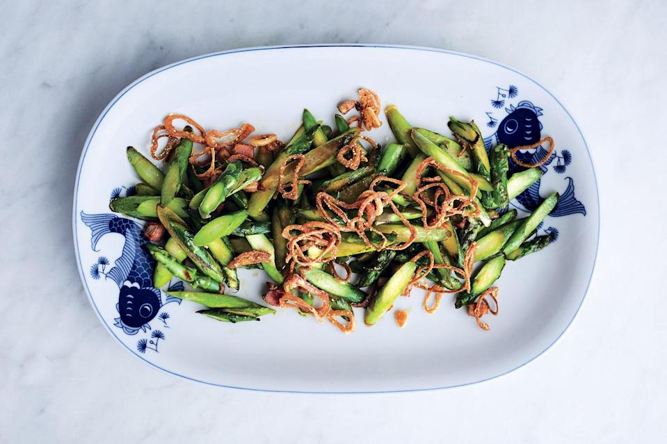 """Wake up a pan of sautéed asparagus with bacon and crispy pickled, fried shallots. <a href=""""https://www.epicurious.com/recipes/food/views/stir-fried-asparagus-with-bacon-and-crispy-shallots?mbid=synd_yahoo_rss"""" rel=""""nofollow noopener"""" target=""""_blank"""" data-ylk=""""slk:See recipe."""" class=""""link rapid-noclick-resp"""">See recipe.</a>"""