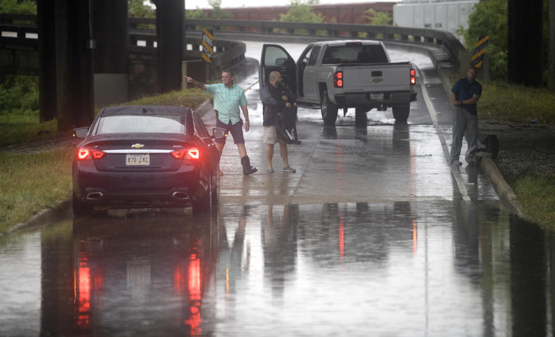 Motorists react as the intersection at Franklin Ave. and 610 in New Orleans floods after a severe thunderstorm Wednesday, July 10, 2019. A storm swamped streets in New Orleans and prompted a tornado warning near the city Wednesday as concerns grew that even worse weather is on the way to Louisiana and other states along the Gulf of Mexico. (Max Becherer/The Advocate via AP)