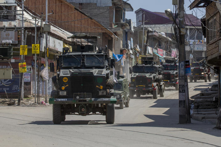 Indian army vehicles leave after the site of a gunbattle in Shopian, south of Srinagar, Indian controlled Kashmir, Friday, April 9, 2021. Seven suspected militants were killed and four soldiers wounded in two separate gunfights in Indian-controlled Kashmir, officials said Friday, triggering anti-India protests and clashes in the disputed region. (AP Photo/ Dar Yasin)