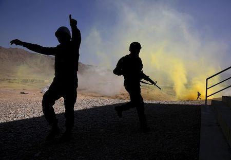 Afghan National Army (ANA) officers participate in a training exercise at the Kabul Military Training Centre in Afghanistan, in this October 7, 2015 file photo. REUTERS/Ahmad Masood/Files