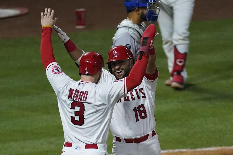 Two Angels players raise their hands to celebrate a homer
