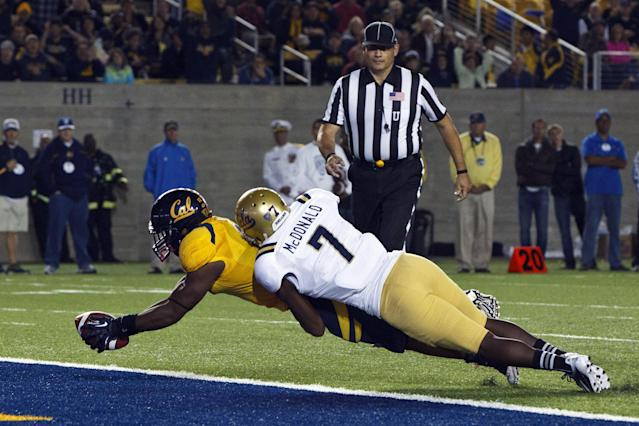 BERKELEY, CA - OCTOBER 06: Running back C.J. Anderson #9 of the California Golden Bears dives for a touchdown past safety Tevin McDonald #7 of the UCLA Bruins during the second quarter at California Memorial Stadium on October 6, 2012 in Berkeley, California. (Photo by Jason O. Watson/Getty Images)