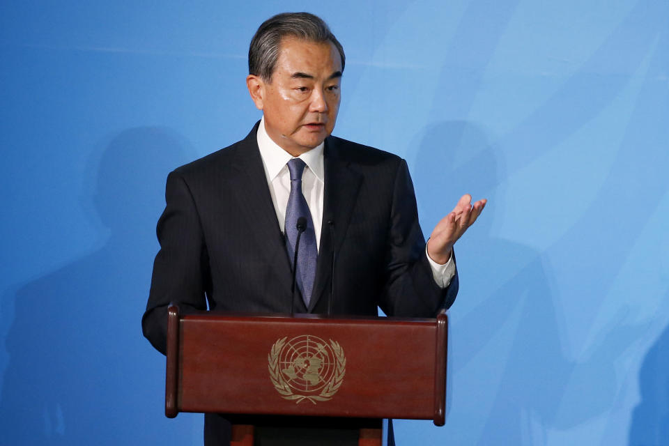 China's Foreign Minister Wang Yi addresses the Climate Action Summit in the United Nations General Assembly, at U.N. headquarters, Monday, Sept. 23, 2019. (AP Photo/Jason DeCrow)