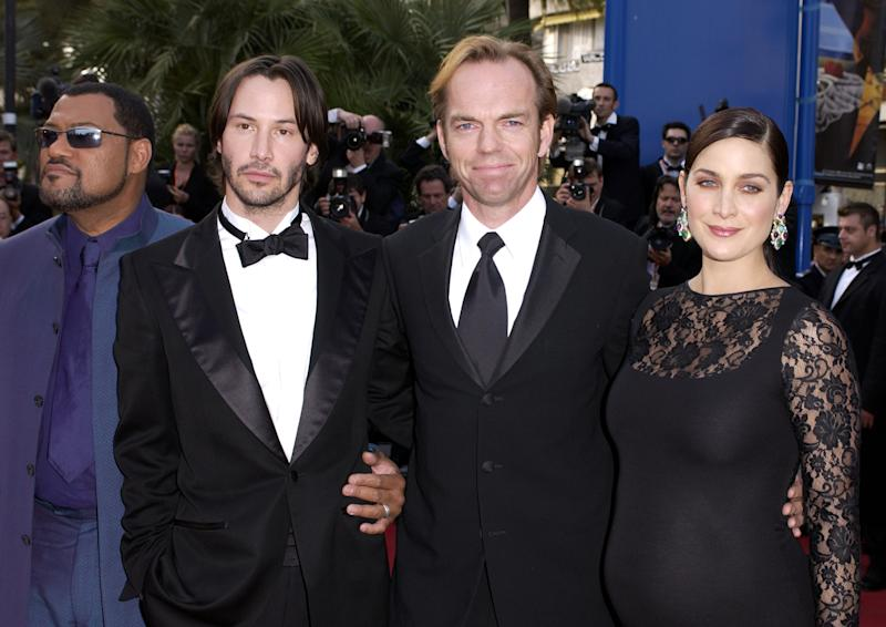 Laurence Fishburne, Keanu Reeves, Hugo Weaving, and Carrie-Anne Moss at the premiere of 'The Matrix Reloaded' in 2003. (Photo by J. Vespa/WireImage)
