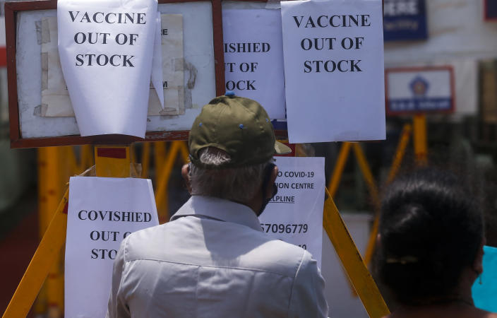 FILE - In this April 20, 2021, file photo, notices informing about the shortage of COVID-19 vaccine is displayed on the gate of a vaccination centre in Mumbai, India. India is battling the world's fastest pace of spreading infections. Its government has blocked vaccine exports for several months to better meet needs at home, exacerbating the difficulty of poor countries to access vaccine. (AP Photo/Rafiq Maqbool, File)