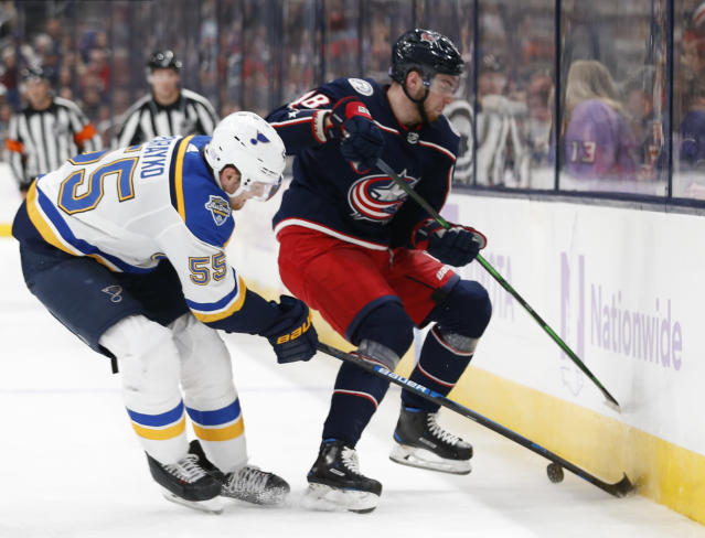 St. Louis Blues' Colton Parayko, left, and Columbus Blue Jackets' Pierre-Luc Dubois fight for the puck during the second period of an NHL hockey game Friday, Nov. 15, 2019, in Columbus, Ohio. (AP Photo/Jay LaPrete)