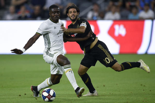 Jul 10, 2019; Los Angeles, CA, USA; Portland Timbers defender Larrys Mabiala (33) takes the ball away from Los Angeles FC forward Carlos Vela (10) during the first half at Banc of California Stadium. Mandatory Credit: Kelvin Kuo-USA TODAY Sports