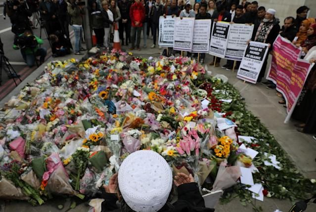 <p>Muslims hold placards near floral tributes for the victims of the attack on London Bridge and Borough Market near the scene of the attack, London, Britain June 6, 2017. (Photo: Marko Djurica/Reuters) </p>