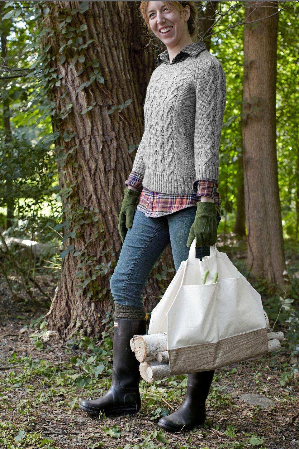 <p>Carry out a seasonal chore in style with a log sling that costs less than $15 to make!</p><p><strong>Step 1:</strong> Turn a canvas bag inside out, then use a seam ripper to undo the gusseted corners. Using scissors, cut the bag along the side seams so that it lays completely flat when open.</p><p><strong>Step 2:</strong> Lay the bag wrong side up. Using a pencil and a ruler, draw and 8 1/2-inch diagonal line across each of the bag's corners. Cut the bag along the lines, as shown; discard corner pieces. Then, fold each cut edge over by 1/4 inch and topstitch in place.</p><p><strong>Step 3:</strong> Cut a piece of faux bois oilcloth that measures 18 1/4''L x 13 1/2W. Flip the bag right side up, then lay the panel across the bag's middle section, as shown. Using bright-orange thread, topstitch the panel in place along its edges.</p><p><strong>Step 4:</strong> Reinforce the handles by folding each strap back on itself. Clamp or pin the strap in place, then stitch it together. Repeat for the second strap.</p>