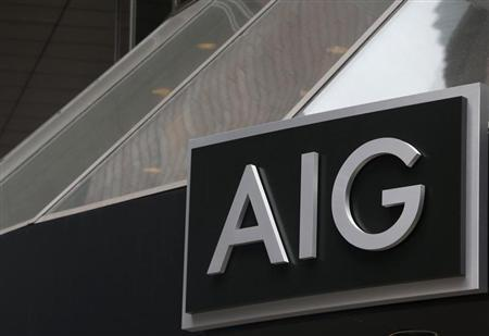 A new sign is displayed over the entrance to the AIG headquarters offices in New York's financial district