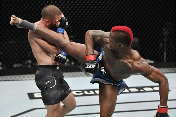 On Sunday, Congolese UFC fighter Marc Diakiese lands a blow on Rafael Fiziev of Kazakhstan in Abu Dhabi.